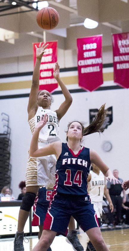 Special to Tribune Chronicle / Dianna Oatridge Diamond Phillips (2) of Warren G. Harding shoots over Camryn Constance of Austintown Fitch Wednesday night at Harding.