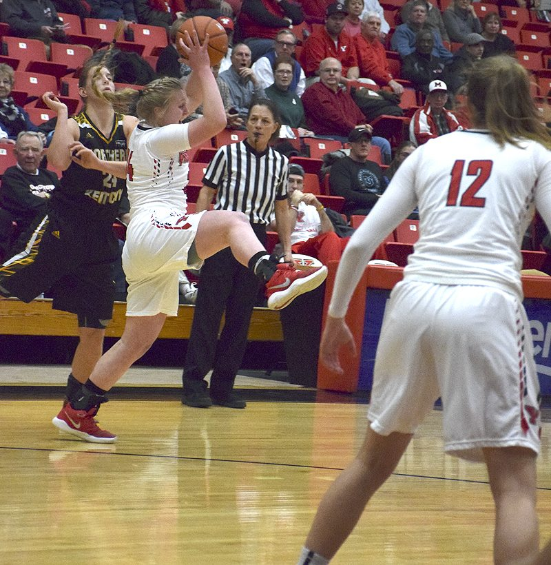 YSU's McKenna Peters, right, steals the ball from Northern Kentucky's Molly Glick.