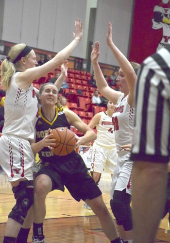 Tribune Chronicle / John Vargo YSU's Sarah Cash, left, and Anne Secrest try to prevent Northern Kentucky's Kailey Coffey from scoring in the lane Thursday night at the Beeghly Center.