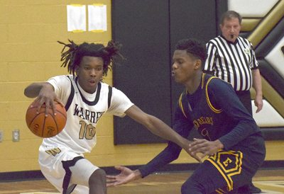 Tribune Chronicle / John Vargo Warren Harding's D'Muntize Owens, left, tries to keep away Youngstown East's Timothy Williams, right, in Warren.