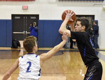 Tribune Chronicle / Marc Weems Poland's Mike Diaz, left, fouls Lakeview's TJ Lynch during their game Friday in Poland.