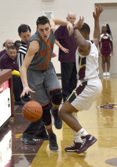 Tribune Chronicle / Joe Simon Newton Falls' Preston Rapczak, left, dribbles near the out-of-bounds line while being defended by Liberty's Dra Rushton, right, during their game in Liberty. Rapczak scored 21 to lead the Tigers to a 58-52 victory.