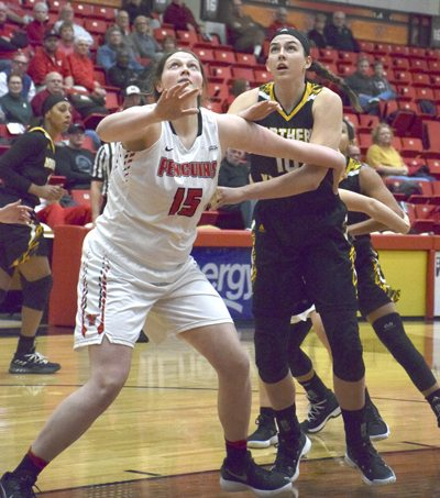 Tribune Chronicle / John Vargo Garfield graduate Grayson Rose, right, now playing for Northern Kentucky, battles for position with YSU's Mary Dunn Thursday night.