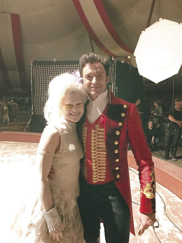 """Special to the Tribune Chronicle Howland native Mishay Petronelli, left, is shown with star Hugh Jackman on the set of """"The Greatest Showman."""""""