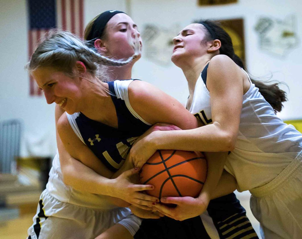 Special to Tribune Chronicle / Dianna Oatridge Brookfield's Dana Sydlowski and Bristol's Alayna Sines, left, and Brittany Moody, right, battle for possession of the ball during Monday's game in Bristolville.