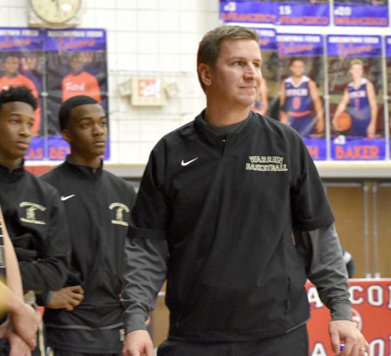 Tribune Chronicle / Joe Simon Warren G. Harding coach Andy Vlajkovich watches during the Raiders' 50-44 loss Tuesday night at Austintown Fitch.