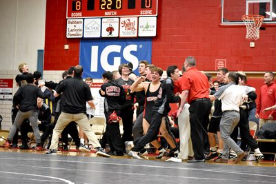 Tribune Chronicle / Joe Simon Members of the Canfield wrestling team celebrate after they won the Division II, Region 12 dual team title Wednesday.