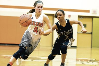 Special to Tribune Chronicle / Dianna Oatridge Warren G. Harding's Diamond Phillips, right, guards Howland's Mackenzie Maze as she dribbles upcourt during their All-American Conference, Red Tier matchup Wednesday. Howland won, 51-34.