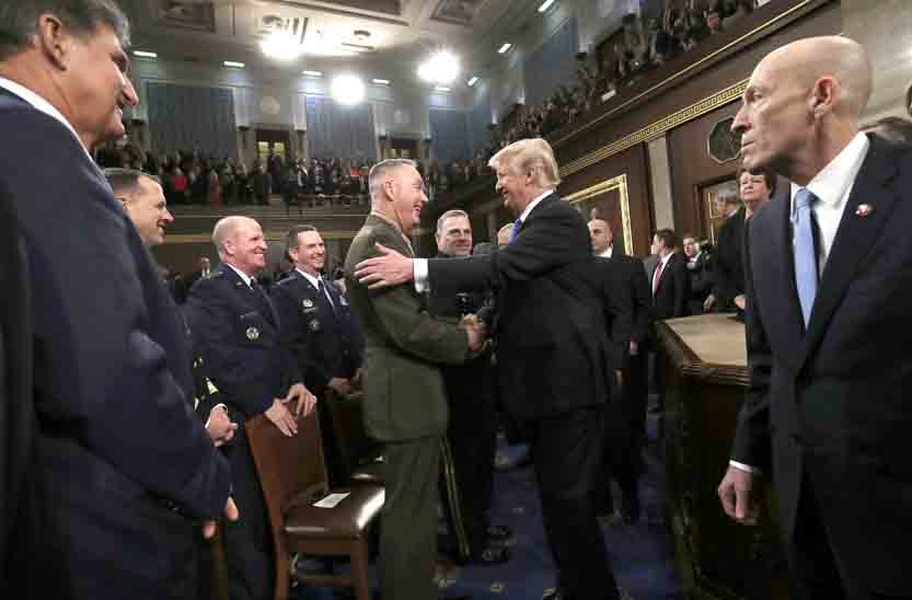AP President Donald Trump greets Chairman of the Joint Chiefs of Staff Gen. Joseph Dunford after delivering his first State of the Union address in the House chamber of the U.S. Capitol to a joint session of Congress Tuesday in Washington. White House officials said Thursday Trump will clear the way for publication of a classified memo on the Russia investigation.