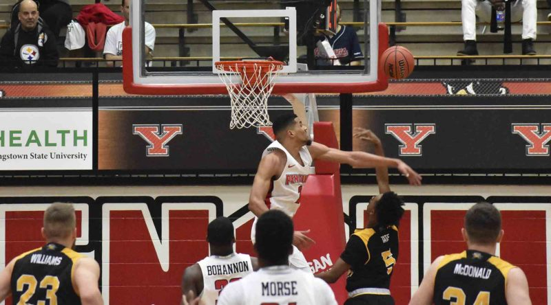 Tribune Chronicle / Marc Weems Youngstown State's Devin Haygood blocks the shot of Northern Kentucky's Jalen Tate during Thursday's Horizon League matchup in Youngstown. The Norse came into the Beeghly Center and defeated the Penguins with a second-half surge, 95-85