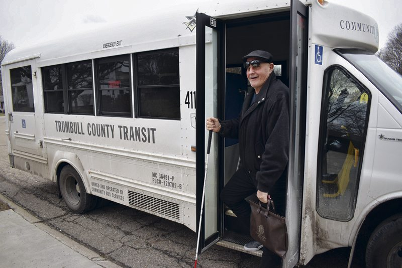 Tribune Chronicle / Renee Fox Carl Clemens, a Trumbull County Transit Board member, senior citizen and disabled man, uses the county tranist system to get to and from work. Clemens said inexperienced drivers have dropped him off at the wrong house five or six times and he is dedicated to ensuring the system works for the people who need it most.
