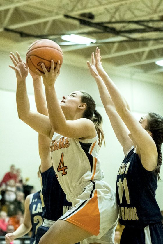 Newton Falls' Libby Barreca makes her way to the hoop past Brookfield's Chloe Willrich.