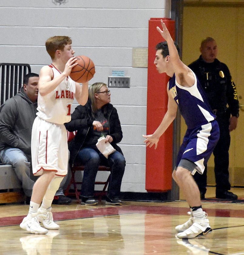 Tribune Chronicle / Marc Weems Champion's Joe Abramovich, right, defends against LaBrae's Broghan Hyland Tuesday.