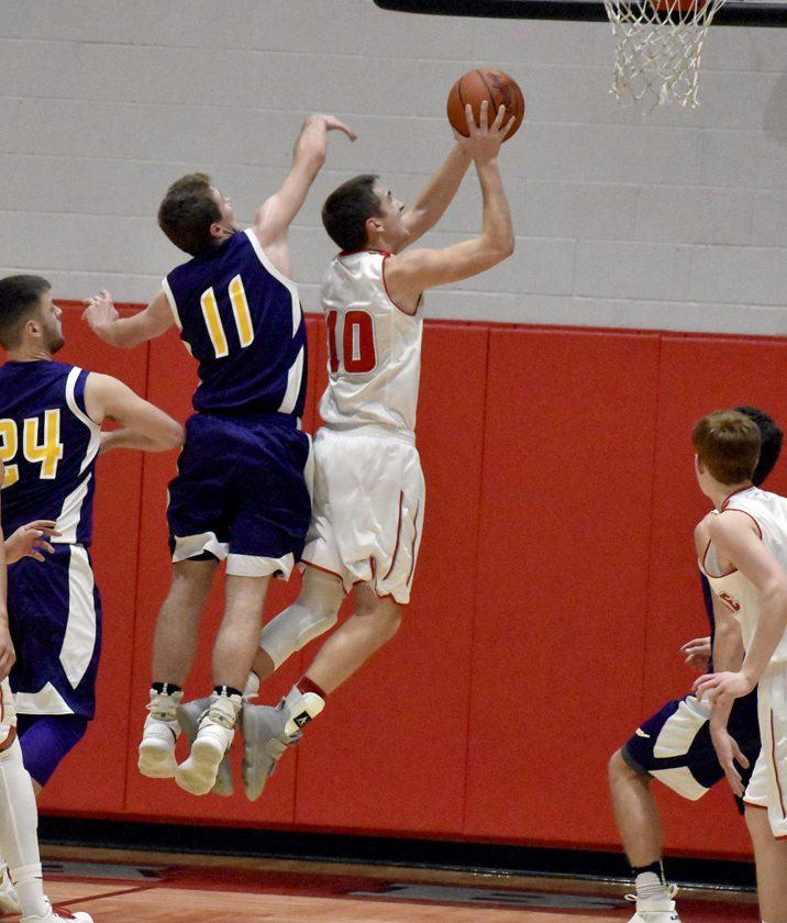 Tribune Chronicle / Marc Weems Logan Kiser (10) of LaBrae gets inside Champion defender Jared Day Tuesday night.