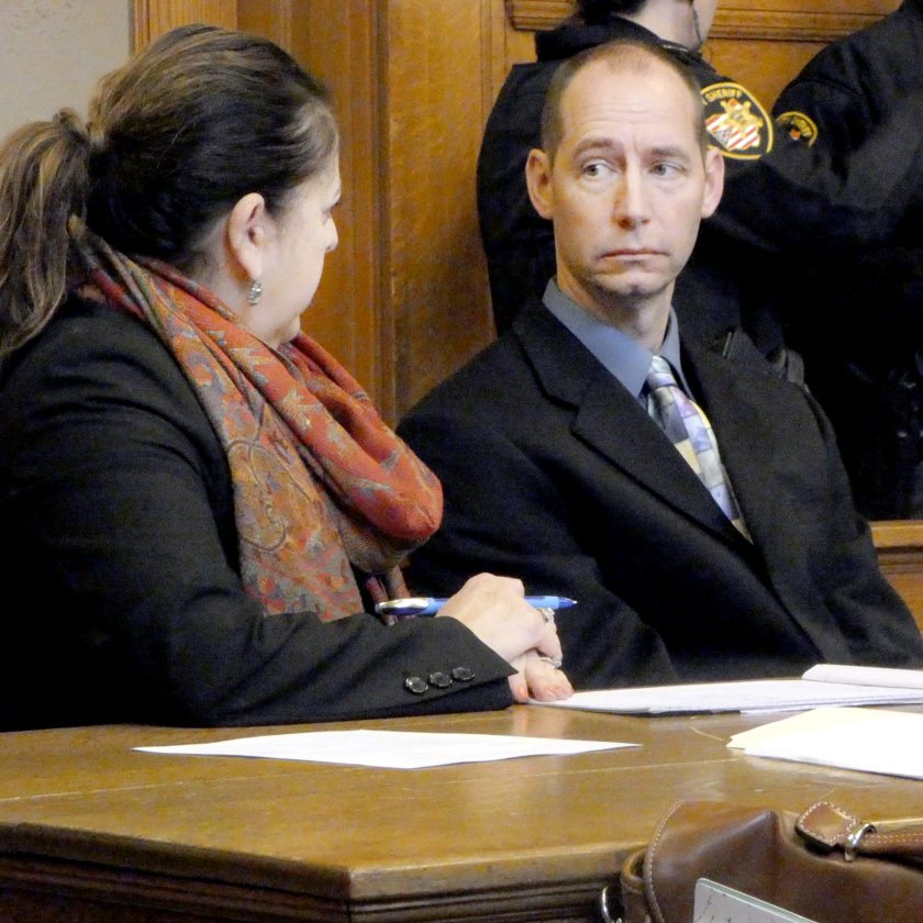 Tribune Chronicle / Raymond L. Smith Defense attorney Miriam Ocasio, left, discusses a probable prison sentence with her client, Richard Knox, a former volleyball coach in Lordstown. Knox was sentenced Wednesday to 18 months in prison for having sexual contact with two students. He also was labeled a Tier 2 sexual offender.