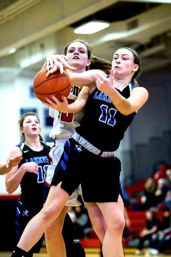 Special to Tribune Chronicle / Dianna Oatridge Lakeview's  Tiffany Bartholomew and Fitch's Rachel DiFrancesco fight for a rebound in Austintown.