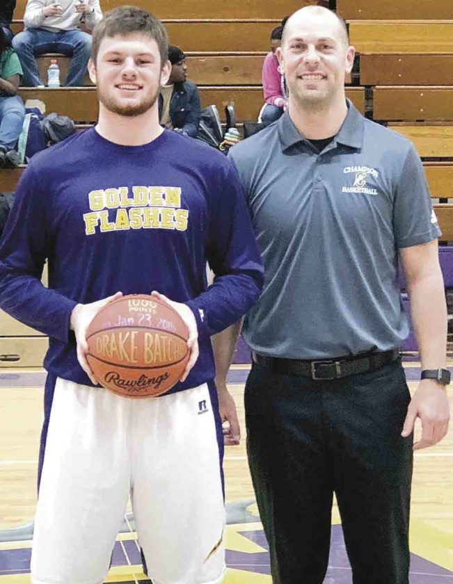 Special to Tribune Chronicle  Champion's Drake Batcho, left, and Golden Flashes boys basketball coach Nathan Kish, right, celebrate Batcho's accomplishment of reaching 1,000 points in his career.