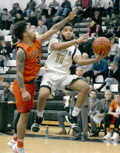 Tribune Chronicle / Marc Weems Trivell Trimble (11) of Warren G. Harding gets past Massillon's Dyson Berry during the Raiders' 39-33 victory at Harding High School.