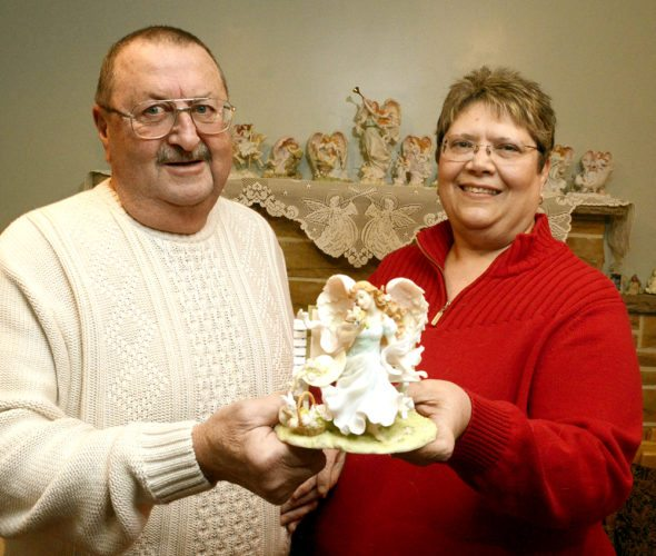 Tribune Chronicle / R. Michael Semple David and Fran Sohayda of Hartford hold the Seraphim Classics Angel on which David offered an engagement ring to Fran 17 years ago. It capped what she said was a perfect Valentine's Day.
