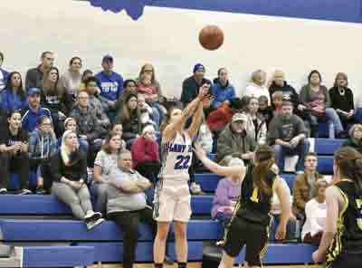 Tribune Chronicle / Marc Weems Jackson-Milton's Michaelina Terranova (22) shoots over Crestview's Mara Halas (1) during their game Monday in North Jackson. Terranova set the school's all-time scoring record during the Blue Jays' 52-39 victory.