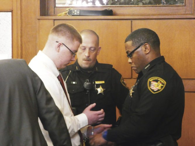 Tribune Chronicle / Guy Vogrin Jacob LaRosa, 18, is taken into custody Tuesday after pleading no contest before Trumbull County Common Pleas Judge W. Wyatt McKay in the March 31, 2015, beating death of Marie Belcastro, 94, who was LaRosa's neighbor. At right is Trumbull County Sheriff's Office deputy Juan Freeman and at center is deputy Mike Nelson.