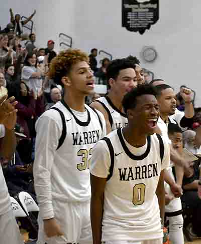 Tribune Chronicle / Joe Simon Warren G. Harding's Delshawn Redd (0) and Elizah Smith, left, celebrate during the Raiders' 61-60 victory over Canton McKinley on Tuesday.