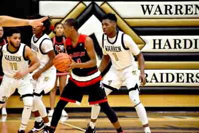 Tribune Chronicle / Joe Simon Warren G. Harding's Terrian Jackson, right, defends Canton McKinley's Za'Vonte Howell during their game Tuesday at Warren G. Harding High School.
