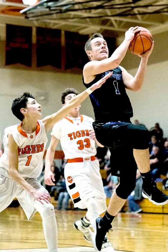 Special to Tribune Chronicle / Dianna Oatridge  Lakeview's Daniel Evans (1) goes in for a lay-up past Newton Falls' Joey Kline (1) and Josh Honeycutt (33).
