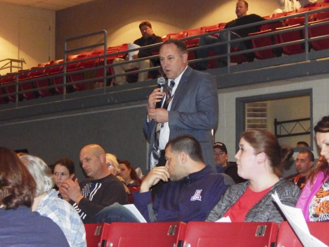 Tribune Chronicle / Bob Coupland Newton Falls Superintendent Paul Woodard, standing,  answers questions of parents and residents Thursday at an informational meeting at the high school on plans to close the elementary school because of declining enrollment and the need to save the district money.