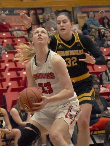 Tribune Chronicle / John Vargo Youngstown State's Sarah Cash goes up for a basket as Milwaukee's Steph Kostowicz defends Thursday in Youngstown.