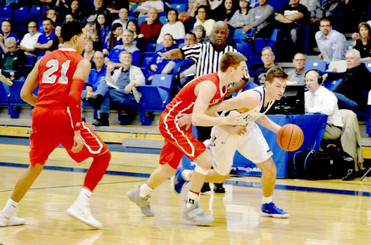 Tribune Chronicle / Joe Simon Poland's Billy Orr, right, is guarded by LaBrae's Logan Kiser, center, during Tuesday's game in Poland. LaBrae's Tyler Stephens is also pictured.