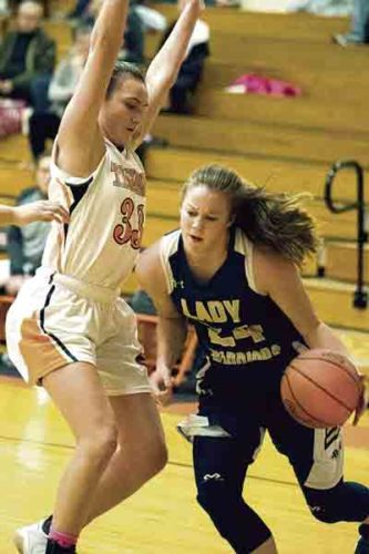 Special to Tribune Chronicle / Dianna Oatridge Brookfield's Bailey Drapola (right), shown here in a game earlier this season against Newton Falls, recently eclipsed the 1,000-point mark for her career. Drapola helped the Warriors capture the All-American Conference, Blue Tier title.
