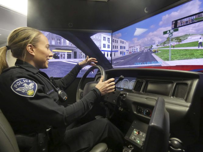 Niles police officer Jennifer Young in the Ohio Attorney General Office driving simulator. The Attorney General's Office offers officers driving safety training with the simulator and they came to the Wellness Center this week to let Niles officers use it. Daniel Pastor, a law enforcement training officer for the Attorney General's Office, said the simulator provides officers with a variety of scenarios that test their ability to multi-task, navigate turns and use mobile data terminals while driving.