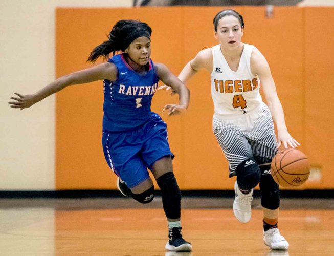 Special to Tribune Chronicle / Dianna Oatridge Howland's Mackenzie Maze dribbles the ball upcourt as Ravenna's Jatia Caples guards her during Howland's Division II sectional bracket final win Thursday night.