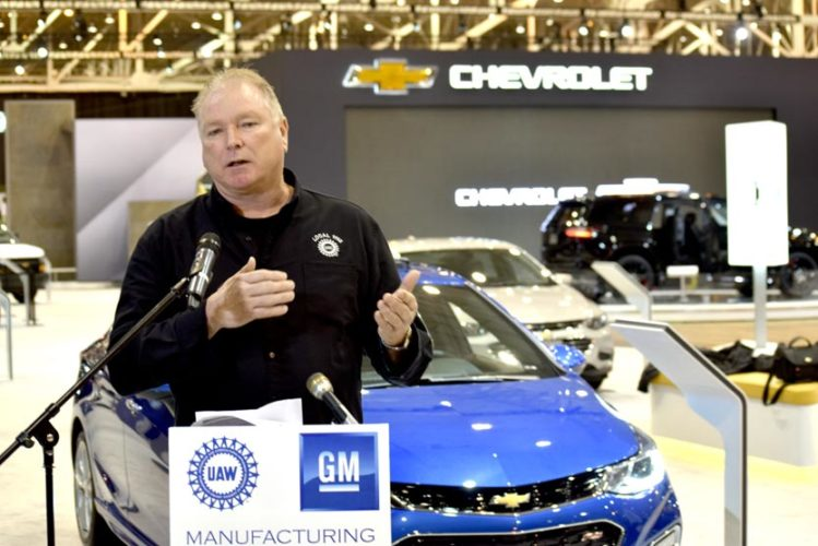 Tribune Chronicle / Liam Bouquet Glenn Johnson, president of United Auto Workers Local 1112 at the General Motors assembly plant in Lordstown, speaks about the Lordstown-built Chevrolet Cruze at the Cleveland Auto Show Friday at the IX Center in Cleveland. The Cruze is one of the centerpieces of GM's display.