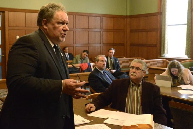 Tribune Chronicle file photo / R. Michael Semple Former Niles Mayor Ralph Infante, seated at right, listens as his attorney, John Juhasz, left, makes a point during a suppression hearing in November. Infante faces dozens of charges related to corruption and theft in office.