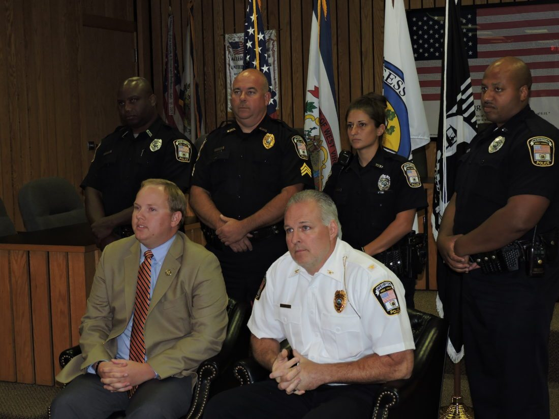 POLICE REPORTS — On Tuesday, Weirton officials responded to a recent news report in which a former city police officer claimed he was terminated in connection to a May officer-involved shooting in the city. Officials say the former officer was terminated for conduct unbecoming an officer following a series of incidents. Taking part in a press conference at the Weirton Municipal Building were, in front from left, City Manager Travis Blosser and Police Chief Rob Alexander, and in back, Detective Gerard Spencer, Sgt. Brian Beatty, Officer Stevie Jo Banannio, and Detective Jason Turner. -- Craig Howell