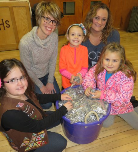 THEYLIKETHOSETABS —  With a purple tub of donated beverage can tabs totaling 57,727 are members of Girl Scouts Troop 51383 at Richmond United Methodist Church, including, from left, Madilin Householder, Leila  Cable and Kloe Riley. They are with their troop leaders Dawn Cable, back left, and Mindie Riley. The troop is continuing to collect tabs through May 9. -- Janice Kiaski