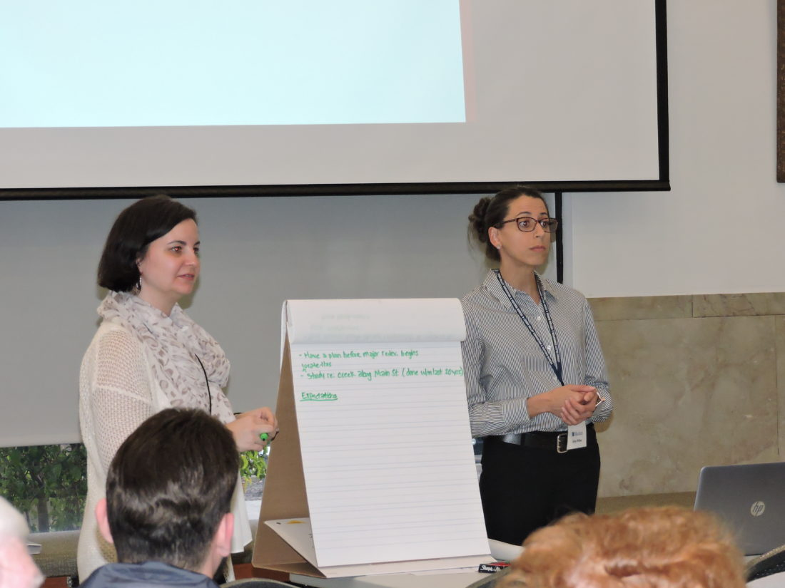 PLANNING SESSION — Brandi Rosselli, left, manager of planning services, and Amy Wiles, lead senior planner, of Mackin Engineering listen to residents during a town hall at the Millsop Community Center Wednesday. The public input session was the first of four planned as part of efforts to update Weirton's Comprehensive Development Plan. -- Craig Howell