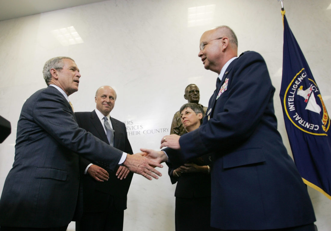 SWORN IN — President George W. Bush shakes hands with Gen. Michael V. Hayden after Hayden was sworn in as the director of the Central Intelligence Agency at CIA Headquarters on May 31, 2006, in Langley, Va. Also on stage were John Negroponte, director of national intelligence, and Jeanine Hayden, Hayden's wife. -- Associated Press