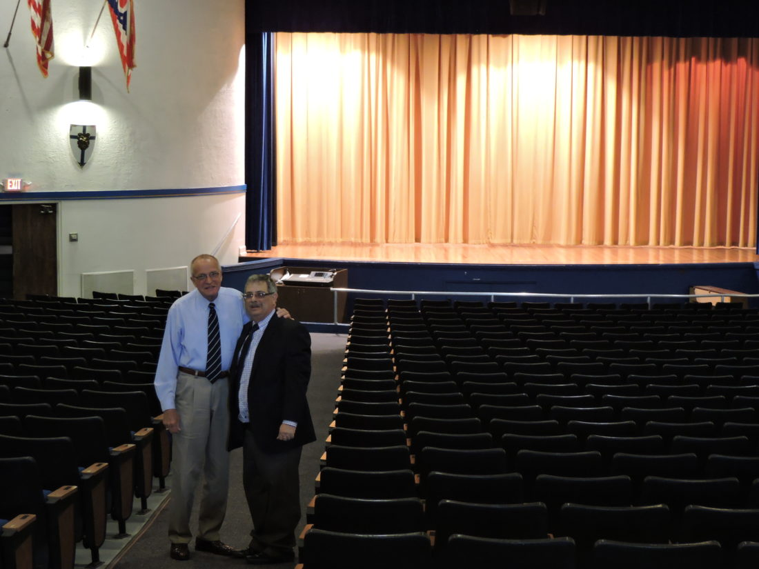SPEAKER SERIES VENUE — Rich Wilinski, left, principal at Catholic Central High School, and Ross Gallabrese, executive editor of the Herald-Star and The Weirton Daily Times, meet in Berkman Theater at Lanman Hall to discuss Thursday's appearance by Michael Hayden as part of the Trinity Health System Presents the Herald-Star Speaker Series. -- Dave Gossett