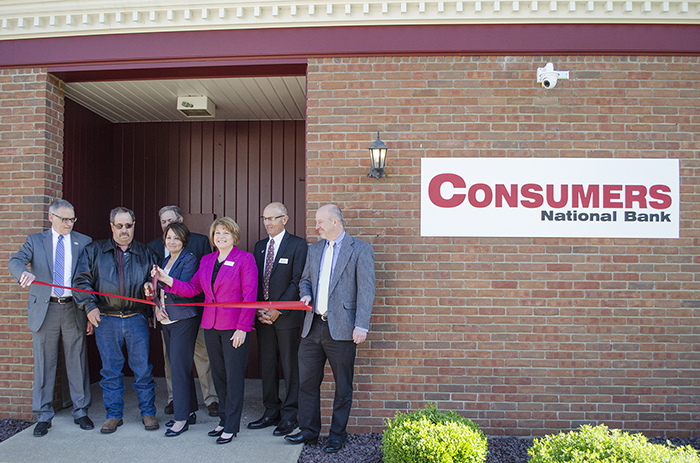 A ribbon-cutting ceremony was held Monday at Consumers National Bank's new branch in Bergholz. On hand were, from left, Ralph J. Lober II, Consumers National Bank president and CEO; Mayor Gary Griffith; Mike Schmuck, director of Consumers Bancorp Inc.; Terri McConnaughy, Consumers sales and service manager; Laurie McClellan, chairman of the board, Consumers Bancorp Inc.; John Furey, vice chairman, Consumers Bancorp Inc.; and Derek Williams, senior vice president, Consumers National Bank. — Contributed