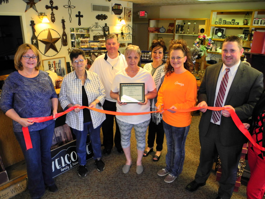 The Wellsburg Chamber of Commerce welcomed Ye Olde Farmhouse Crafts, a new store offering an assortment of handmade decorative items from Amish country and elsewhere, with a ribbon cutting. Taking part were, front, from left,  Jacie Ridgely, chamber coordinator; Jane Minda; Shirley Seymour; owner; Wendy Vincent; and David Klick, chamber president: and back, chamber members Joe Mullenbach and Nanci Walker. — Warren Scott