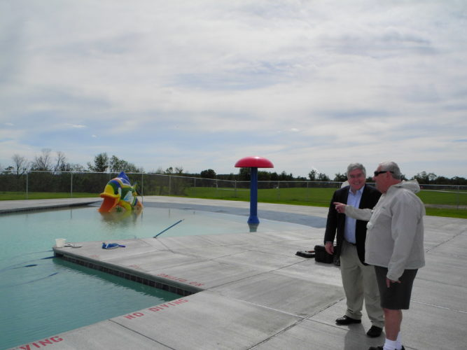 "West Virginia Attorney General Patrick Morrisey, left, got a look at the new swimming pool at Brooke Hills Park during a tour led by park board member Paul ""Bud"" Billiard. Morrisey was at the park Monday to discuss the opioid addiction problem with representatives of area schools and community agencies. Joe Mullenbach, board president, was on hand during the tour. — Warren Scott"