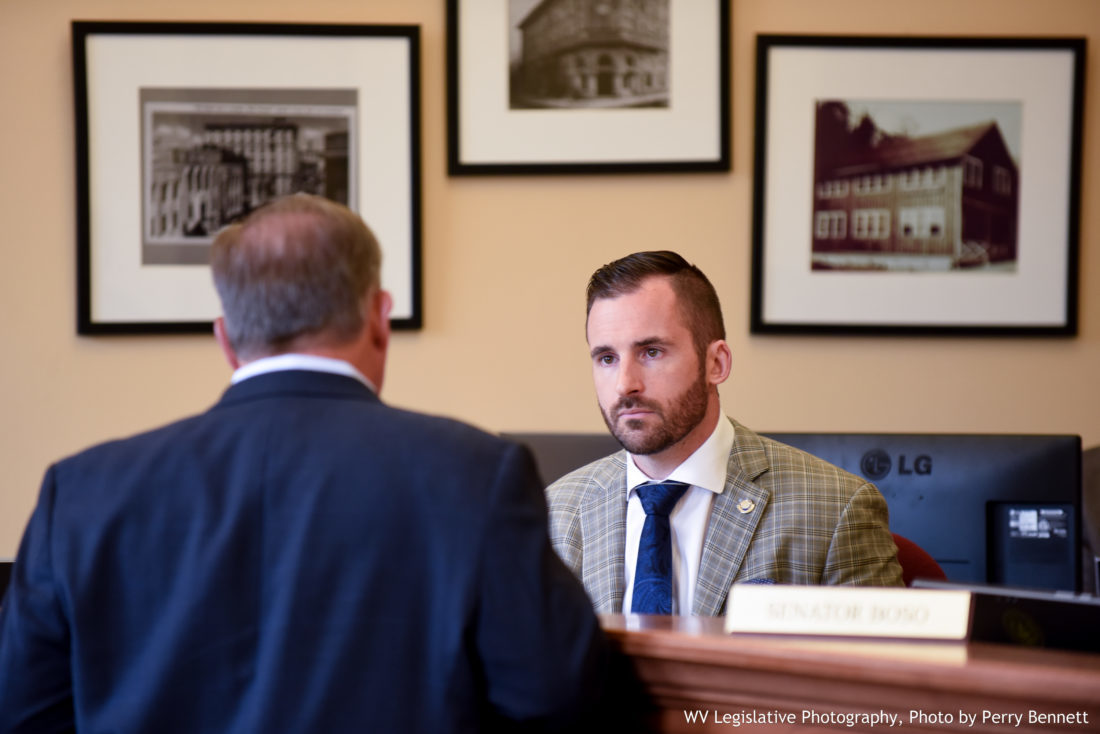 West Virginia Senate Majority Leader Ryan Ferns, R-Ohio, speaks with Sen. Ed Gaunch, R-Kanawha, before a Senate Select Committee on Tax Reform meeting Monday at the Capitol. — Perry Benett/West Virginia Legislature