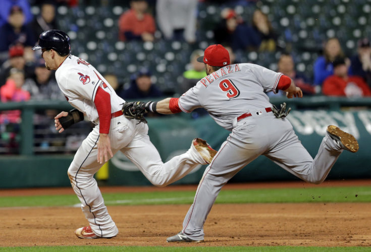 Cincinnati Reds' Jose Peraza, right, tags out Cleveland Indians' Bradley Zimmer is caught trying to steal to third base in the sixth inning of an interleague baseball game, Wednesday, May 24, 2017, in Cleveland. Zimmer was out on the play . (AP Photo/Tony Dejak)