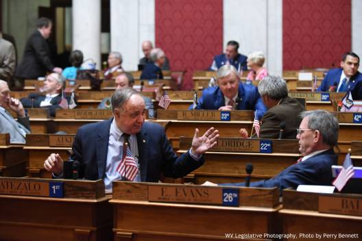 West Virginia Delegate Mark Zatezalo, R-Hancock, left, speaks with Delegate Ed Evans, D-McDowell, Wednesday on the House floor. — Perry Bennett/West Virginia Legislature