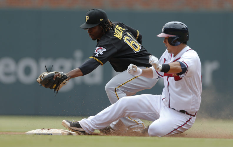 Atlanta's Kurt Suzuki is safe at second base with a double as Pittsburgh second baseman Gift Ngoepe handles a late throw in the ninth inning Thursday, in Atlanta. Pittsburgh won 9-4. — Associated Press