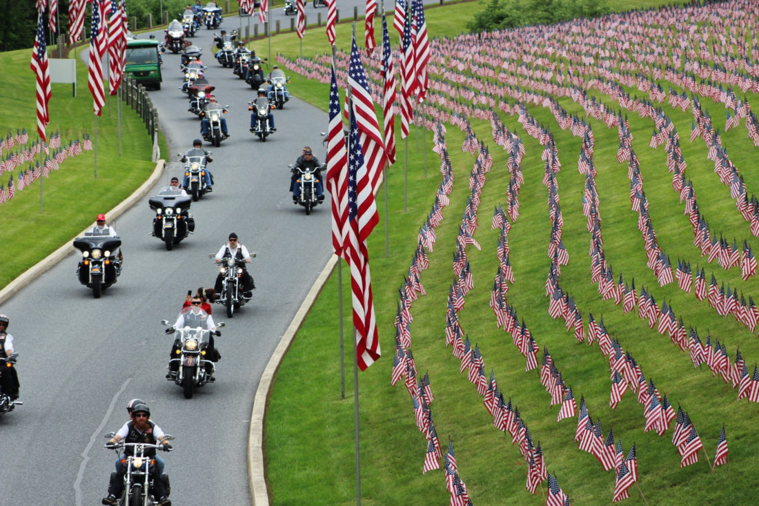 Motorcyclists ride into Indiantown Gap National Cemetery in Annville, Pa., Friday, for a Memorial Day weekend program. While millions of Americans celebrate the long Memorial Day weekend as the unofficial start of summer, some veterans and loved ones of fallen military members wish the holiday that honors the nation's war dead would command more respect. -- Associated Press