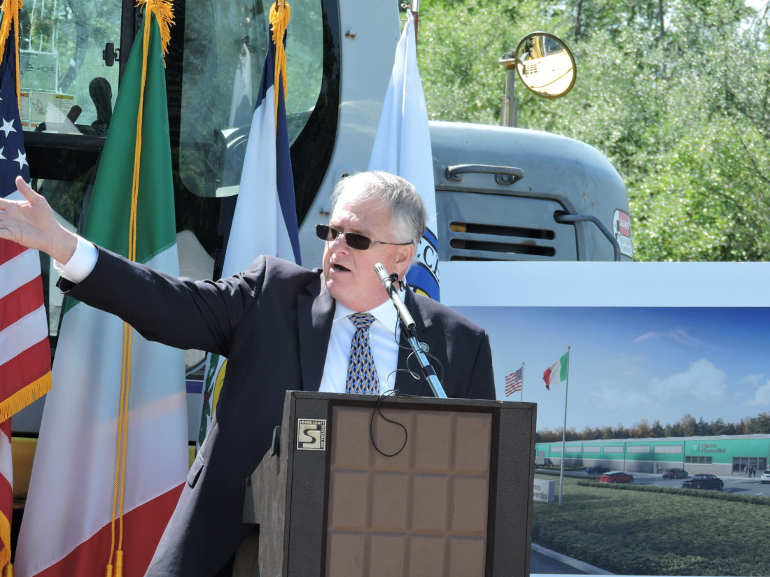 Dave Watkins, president of Pietro Fiorentini USA, addresses the crowd gathered in the Three Springs Business Park Friday prior to the ceremonial groundbreaking for the company's new Weirton facility. The factory will be the company's first permanent operation in the United States. -- Craig Howell